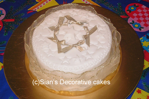 Christmas cake with bows and stars