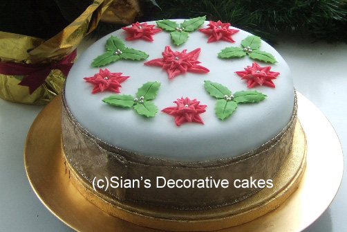 Christmas cake with red and green holly