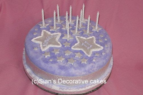 Birthday cake with silver stars