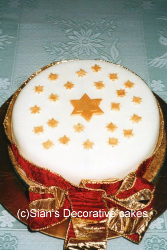 Christmas cake with gold stars